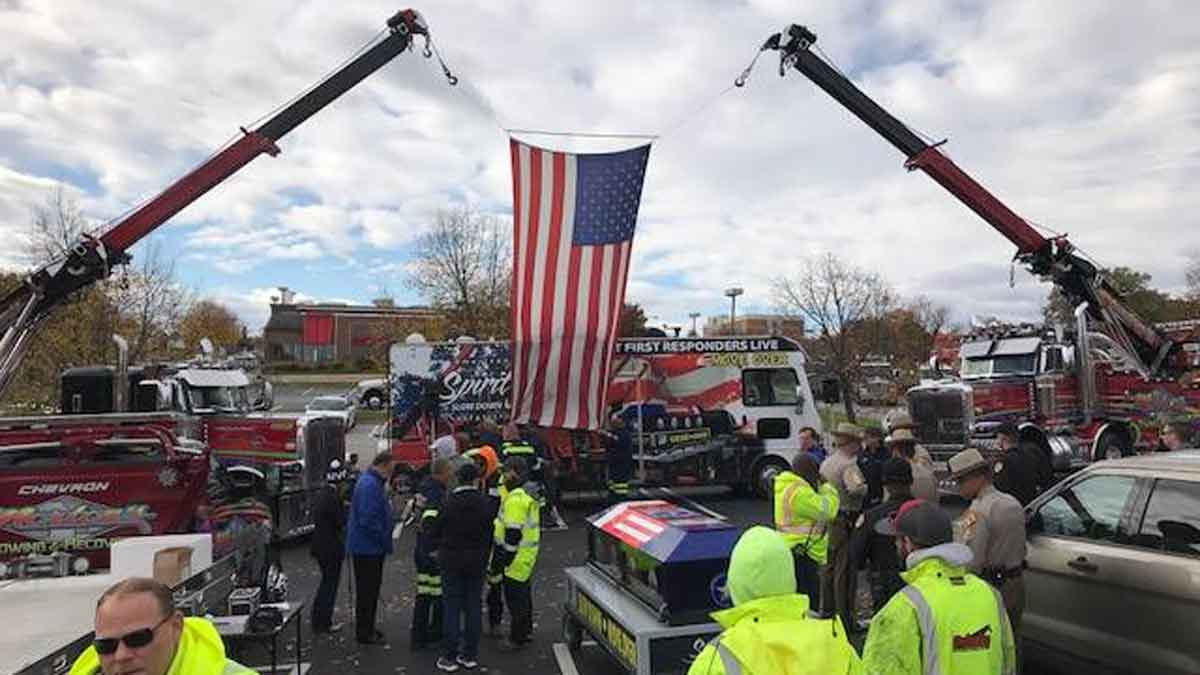Spirit Ride Trucks Hoisting Flag
